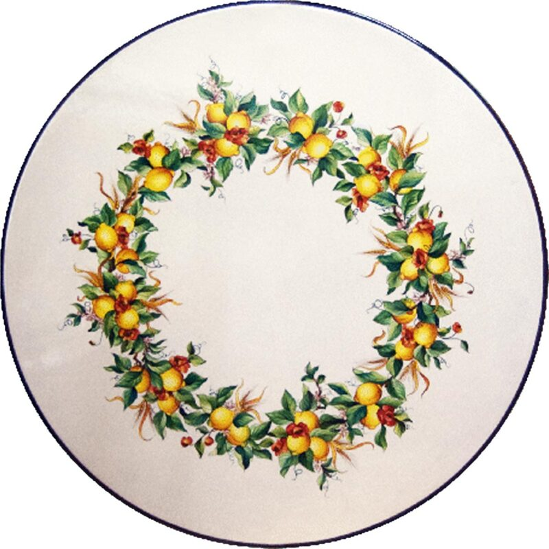 Round lava stone table with poppies and lemons decoration