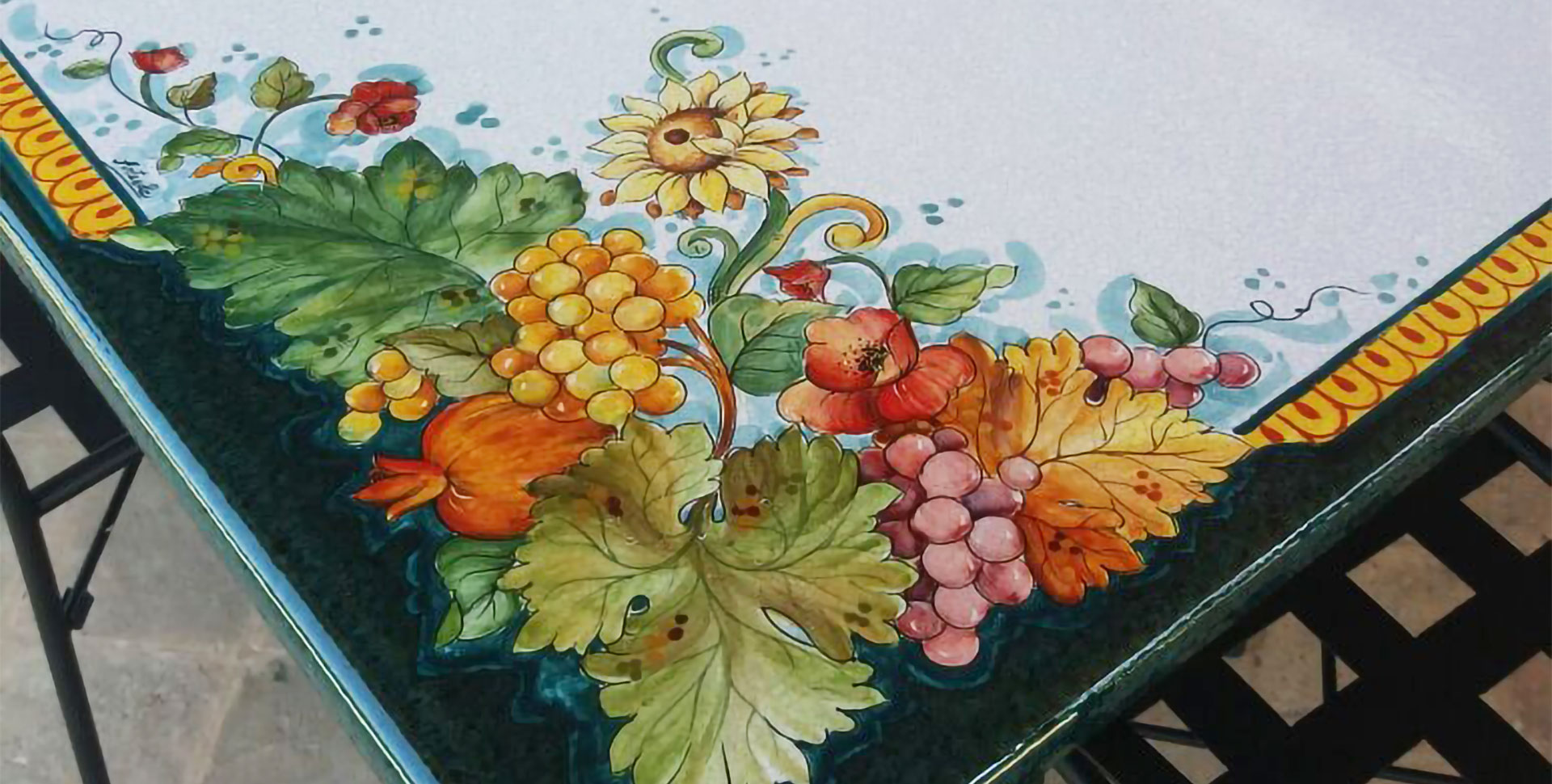 hand painted decorative detail on rectangular lava stone garden table