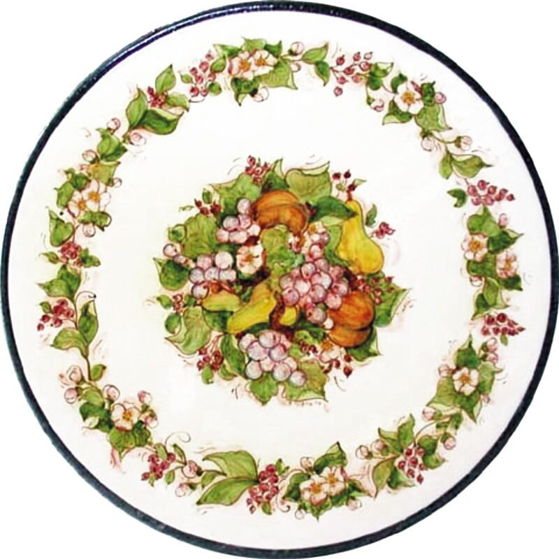 round lava stone table with flower and fruit decoration