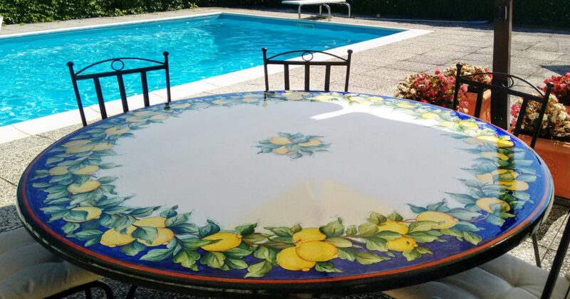 Lava stone table with lemons decoration on poolside